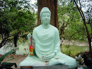 """Photo: Turquoise Karma +TurquoiseThursday #TurquoiseThursday Curated by +Tatiana Parmeeva+History Thursday #HistoryThursday Curated by +Matt Shalvatis#TheoreticalThursday Curated by +Jason Dell:- Quiet, tranquil and very peaceful. This statue sits with it's back to a lake in he temple complex of Wat Umong in the city of Chiang Mai , northern Thailand. Wat Umong is located against the mountains of Doi Suthep and is just outside the city center. The temple itself was built in 1297 by King Manglai of the Lan Na dynasty.The entire complex consists of 37.5 rai (15 acres) of wooded grounds. It's nickname is the """"The Forest Wat"""" (Wat is Thai for temple).The wat is famous for its ancient tunnels and large stupa.These tunnels were supposedly built by the King and painted with bush scenes so they could keep a famous but mentally deranged monk within the grounds of the monastery as he had a habit of just wandering off into the bush for days on end.Wat Umong is unique in that the resident monks live in a very natural setting, and occasionally feed the deer that live in the area. Information and some of the text here from Wikipedia( (http://en.wikipedia.org/wiki/Main_Page). I have been to this temple many many times as my step daughter love to go in the tunnels as well as feed the fish, turtles, and ducks in the large pond.  Photography by Justin Hill ©"""