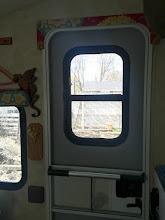 Photo: Door window and screen door cross bar installed!