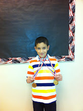 Photo: 3rd Place 100 Meter Run and Archery Mahmoud Ismail
