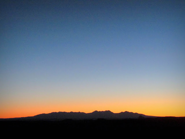 Glowing sky behind the La Sals just before 7AM