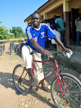 Photo: Having a bike will save Mahamad many hours of walking each week. He uses the bike to ride to and from school in Bulenga, and also rides to neighboring villages to find work. Mahamad says he will always use oil for the chains and will take good care of his bicycle.