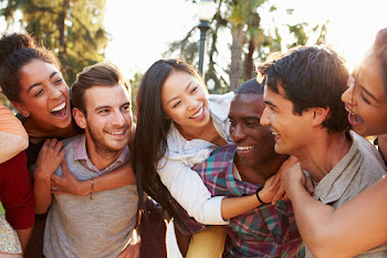 Diverse friends laughing together outside