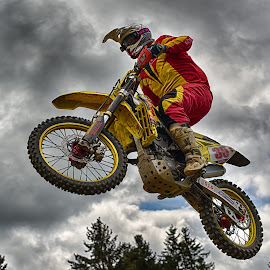 Above All ! by Marco Bertamé - Sports & Fitness Motorsports ( clouds, speed, 35, number, yellow, race, noise, jump, flying, red, motocross, grey, air, high )