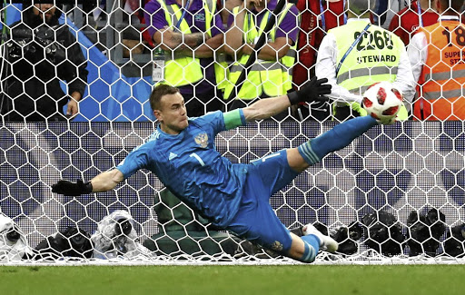 russian goalkeeper gives spain the boot