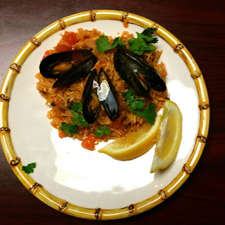 Paella with Clams And Mussels.