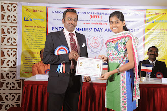 Photo: Prof. Dr. R. Ganesan, Chairman, NFED Issuing Certificate of Appreciation To Ms. M. Nethra, I Year MBA, PSGIM, Coimbatore