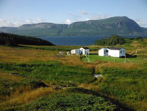 Photo: Blow Me Down Mountain with a small cottage community at Woods Island Harbour.