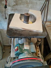 Photo: using the drum sander to fine tune the inside radius of the new backing plate