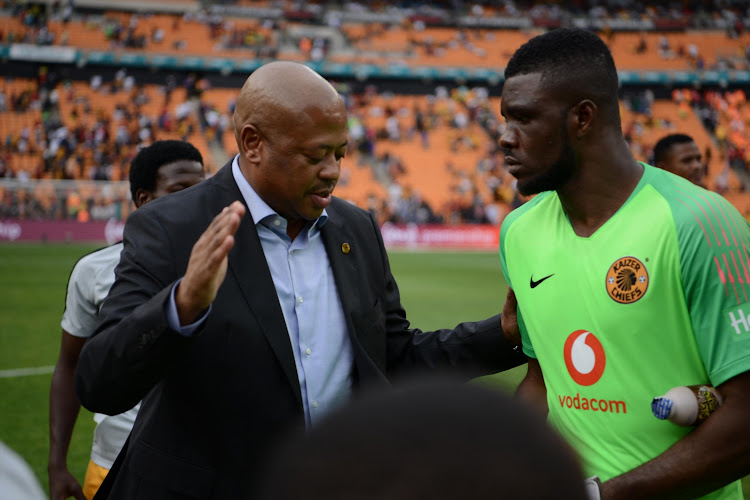 Kaizer Chiefs football manager Bobby Motaung congratulates goalkeeper Daniel Akpeyi after a match.