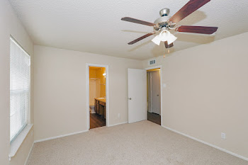Durham bedroom with carpet and ceiling fan