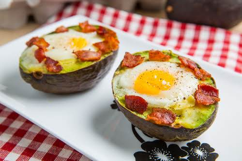 "Baked Avocado Bacon and Eggs""Warm and creamy avocados baked with eggs in..."