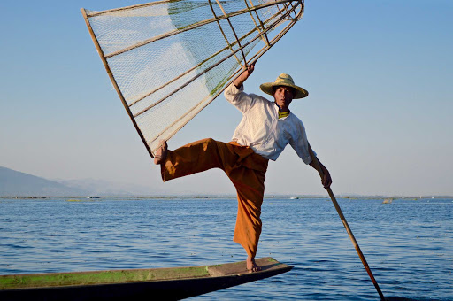 inle-lake-fisherman.jpg - A fisherman balances on his boat while fishing on Inle Lake, Myanmar.