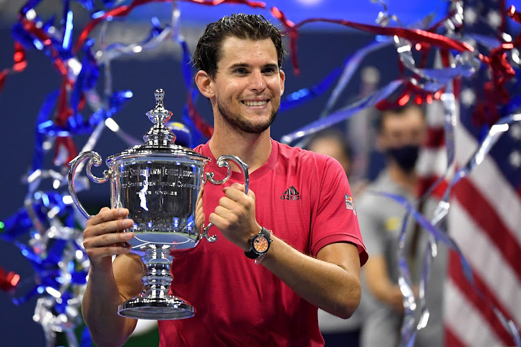 Dominic Thiem of Austria celebrates with the championship trophy.