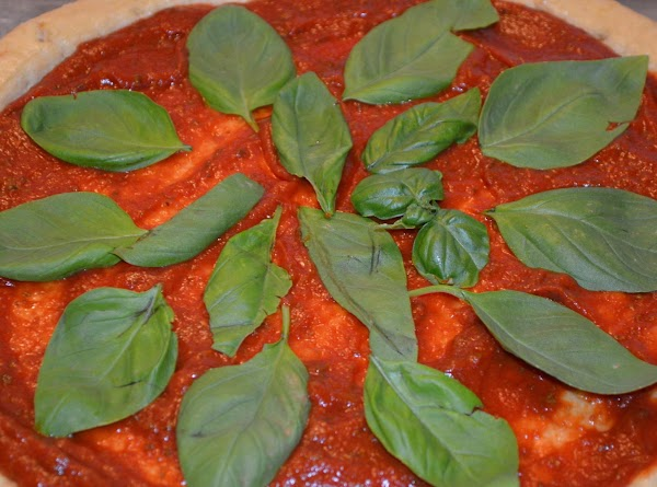 Sauce should sit for 30 minutes to blend flavors; spread over pizza dough and...