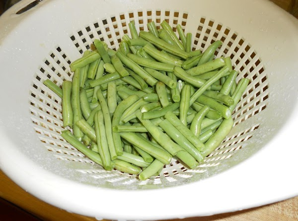After snapping the ends off green beans and breaking them in half, soak them...