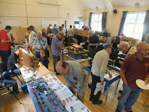 Photo: 001 Lots of well known narrow gauge modelling faces to be seen in this view across the hall during the early afternoon. (I know it is after lunch as Martin Collins' plate is empty! ) .