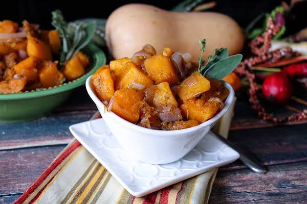 A Small Bowl Of Butternut Squash And Shallots.