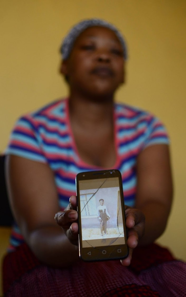 Lerato Khukhwane holding her cell-phone projecting Lesego Khukhwane an 18 years old girl who lost her life at Mmabatho Stadium over the weekend during Mahika-Mahikeng music and cultural festival.