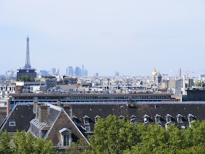 Photo: Here over the rooftops is the Eiffel Tower, the La Defense complex, and (if you look carefully) the golden dome of Les Invalides.
