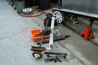 Photo: Rear axle disassembled with cleaned aluminum frame.  Frame ready for new 1x1 pieces.