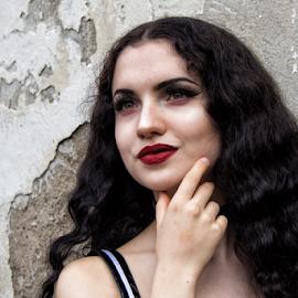 Black hair woman by Gianluca Presto - People Portraits of Women ( black hair, woman, candid, red lips, girl, portrait, people, wall, curls )