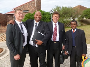 Photo: Elder Acton, the Cleary Branch President, Elder Stokoe and Joshua Mosia who owned a pickup truck and transported our furniture.  Brother Mosia, a Zulu,  was a dynamic, fun teacher. We really enjoyed him.  He worked as a handy man, a jack of all trades.
