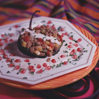 Chiles en Nogada (Poblanos stuffed with Picadillo and Walnut Sauce).
