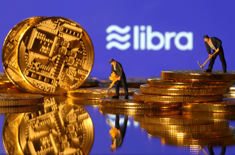Small toy figures are seen on representations of virtual currency in front of the Libra logo in this illustration picture. Picture: REUTERS/DADO RUVIC