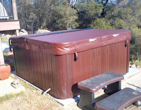"""Photo: Here is a picture of our newly delivered hot tub on top of our ez pad.  """"We love our EZ Pad. Saved us hundreds of dollars in contracting fees and better yet we can move it if ever needed. It took all of 15 minutes to unpack and put together. Everything worked out great.""""  Thanks,  Eric and Lynn K."""