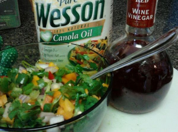 Drizzle very lightly with oil, (about 2 teaspoons.)  Then add red wine vinegar....