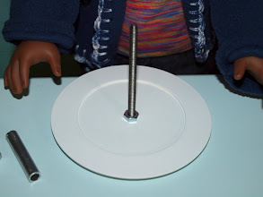 Photo: Start by screwing the larger plate onto your screw and add a nut.