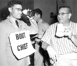 Photo: W.D. Gallatin, EOCA, left, reports to F.H. Kane, ACC CPO President, what he sees in his coke bottle binoculars.
