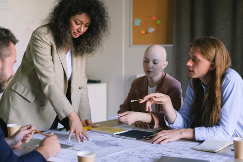 Focused colleagues brainstorming in boardroom