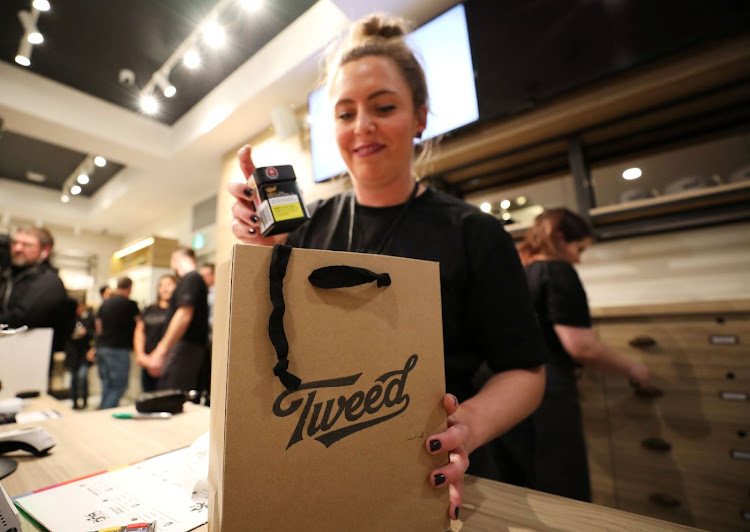 An employee packs purchases into a shopping bag after the first legal recreational marijuana sale after midnight at a Tweed retail store in St John's, Newfoundland and Labrador, Canada, on October 17 2018. Picture: REUTERS/CHRIS WATTIE