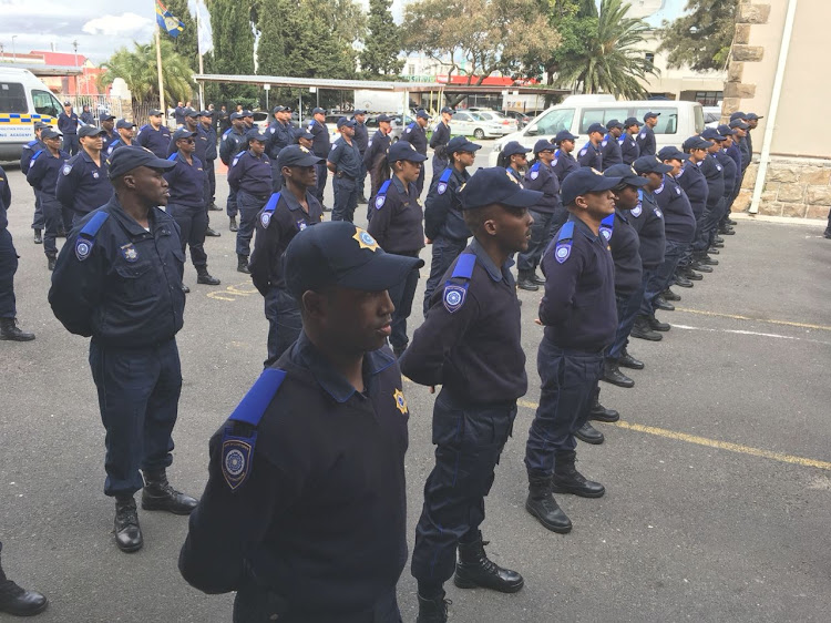 Some of Cape Town's 70 trainee rail enforcement unit officers on parade in Observatory on September 12 2018. Picture: ANTHONY MOLYNEAUX