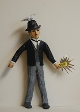 "Photo: Tesla Action Figure, 13 x 8 x 3"", paper mache"