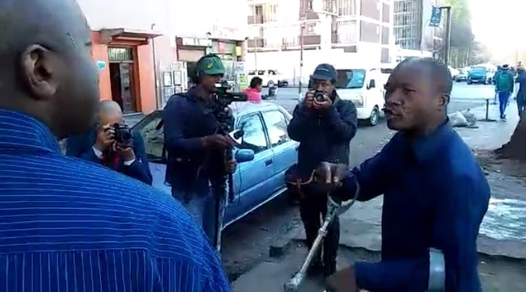 Tshwane mayor Solly Msimanga classes with a man in Johannesburg CBD.