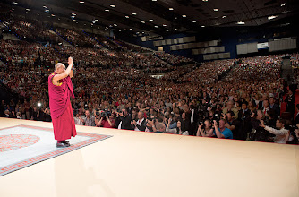 "Photo: His Holiness the Dalai Lama greeting the audience at the Vienna Stadthalle before his talk ""Beyond Religion - Ethics for the Whole World"" in Vienna, Austria, on May 25, 2012. Photo/Tenzin Choejor/OHHDL"