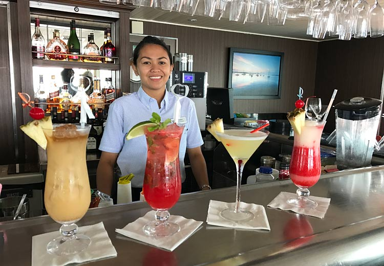 Maria Lawag, mixologist on Wind Surf, with four cocktails perfect for the Caribbean — and to keep the tropical vibe going at home.