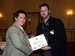 Photo: Matthew Edmonds receives an ASHRAE Research Donation award on behalf of Longhill Energy