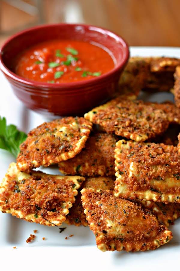 Toasted Ravioli Are Seasoned Breaded Ravioli That Are Deep Fried And Served With Marinara And A Sprinkle Of Parmesan Cheese.