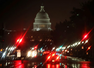 Photo: WASHINGTON, DC - OCTOBER 10: Pennsylanvia Ave. and the U.S. Capitol is shown on a rainy morning on October 9, 2013 in Washington, DC. The U.S. government shutdown is entering its eleventh day as the U.S. Senate and House of Representatives remain gridlocked on funding the federal government.  (Photo by Mark Wilson/Getty Images)