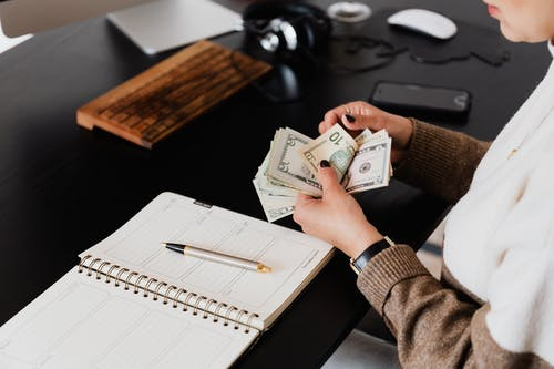 Crop entrepreneur counting money in office
