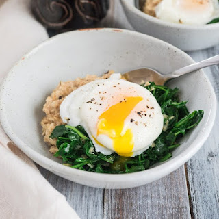Savory Oatmeal with Wilted Arugula and Poached Eggs Recipe