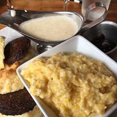 Sausage biscuits and gravy with grits brunch