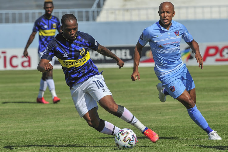 Aubrey Ngoma turns away from Kurt Lentjies during the match.