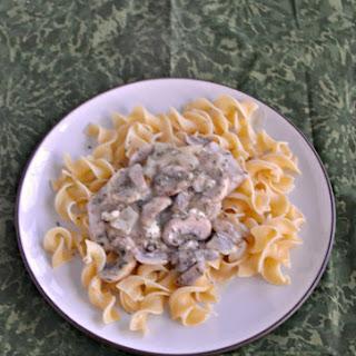 Mushroom Smothered Pork Chops over Noodles #SundaySupper.
