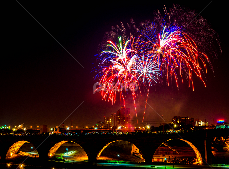 Firer Works Over Stone Arch Bridge by Tina Hailey - Abstract Fire & Fireworks ( minnesota, stone arch bridge, tinas captured moment, minneapolis, fireworks, city,  )