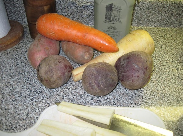 Preheat oven to 400F, (200C or Gas Mark 6)Peel and cut the vegetables into...