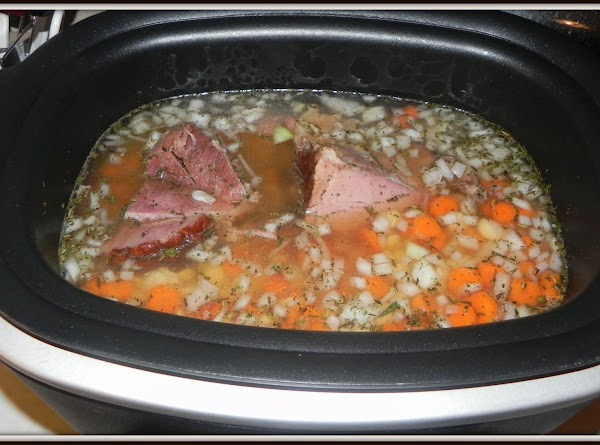 Add your vegetable broth, carrots, onions, garlic and the rest of the ingredients. Add...